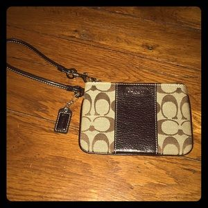 Coach wristlet: brown fabric and leather